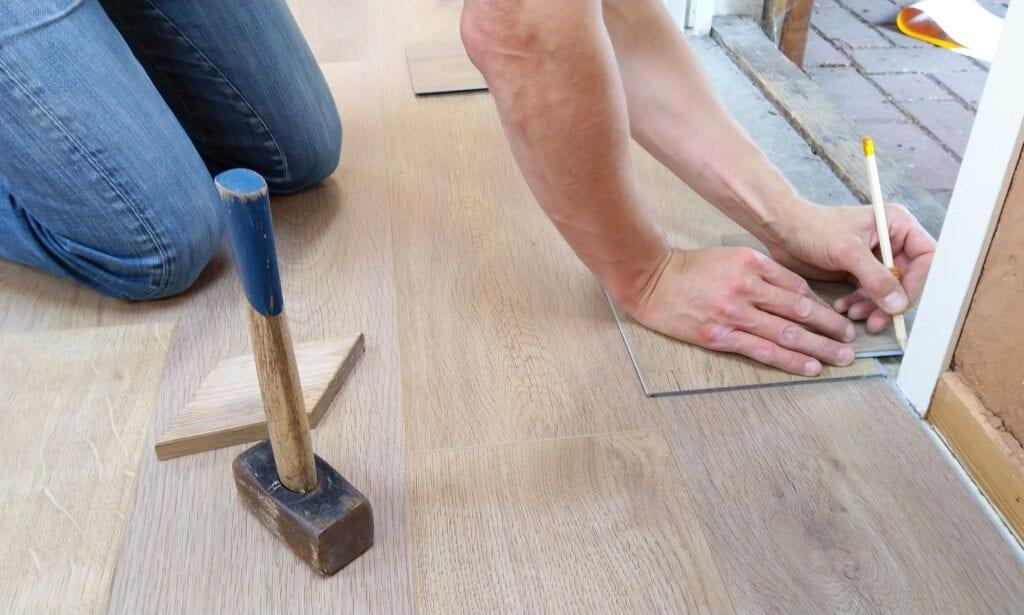 techniian installing wood floor