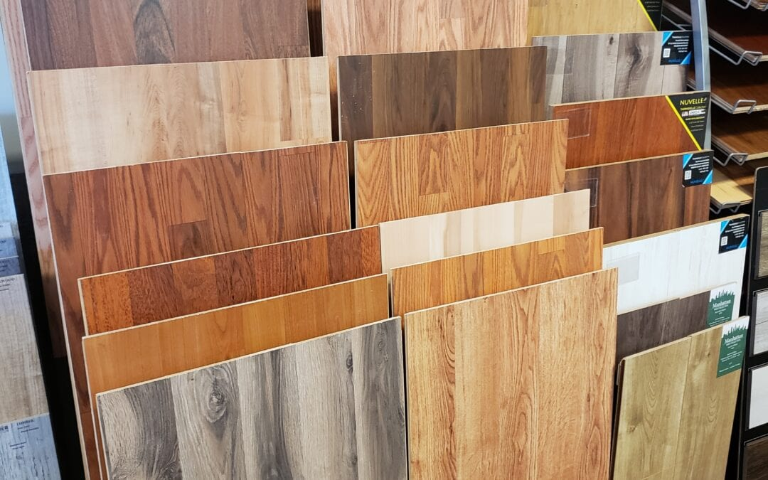 Tricolor Flooring's assortment of Nuvelle Flooring ®samples in a rack