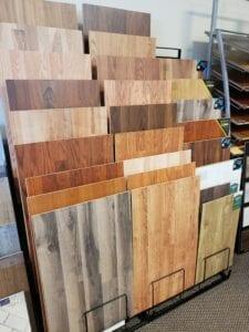 Tricolor Flooring's assortment of floor samples in a rack